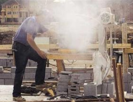 Figure 2: Fugitive dust blown into the air from a concrete saw.