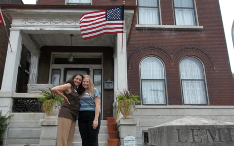 "My mom and I posing for a picture outside the former ""Luecke house"" on Lemp street in St. Louis, MO. The Luecke family reunion, organized by Eric Luecke, brought together more than fifty family members."