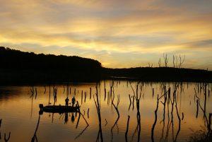 fishermen on a lake